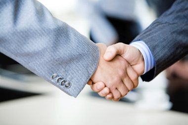 stock photo 5595939 two businessmen engaging in a handshake